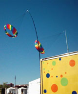 Here are some new toys in action, bright and cheery festival wind spinners mounted on our truck.
